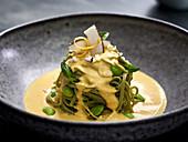 Edama noodles in a creamy lemon and basil sauce