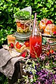 Picnic set on a stump, salad in jars