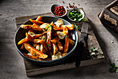 Canadian poutine (fast food specialty made from french fries, cheese, and gravy)