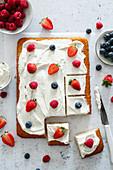 Yogurt cake with mascarpone and fresh fruit topping