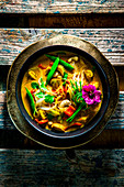 Asian chicken and coconut soup with glass noodles