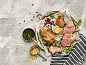 Roast Lamb Rack with Herb Sauce and Promegranate