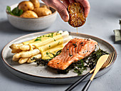 White asparagus with hollandaise sauce and baked salmon