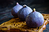 Three figs on an old wooden stand