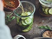 pickling cucumber slices with mustard seeds