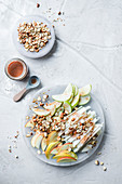 Kohlrabi and apple salad with nuts and currant dressing