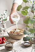 Pour milk over muesli
