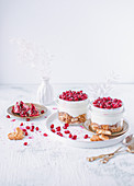 Oatmeal cookies with whipped cream and pomegranate