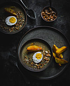 Vegetarian sour soup with eggs and baked potatoes