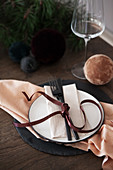 Place setting decorated with velvet ribbon
