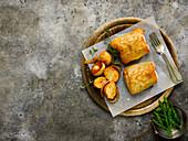 Filet mignon Wellington with baked potatoes