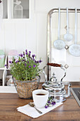 Lavender in a wire basket and kettle in a nostalgic kitchen