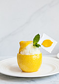 A scooped out lemon half filled with lemon granita