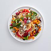 Citrus salad with diced pumpkin and Roquefort