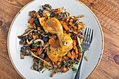 Fried chicken on the bone with mushrooms and carrot