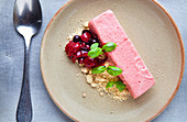 Strawberry mousse with a fruit compote, biscuit crumb and fresh basil