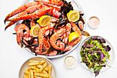 Seafood platter with king prawns, crab and seaweed