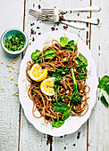 Spelled spaghetti with spinach, broccolini and pesto