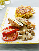 Stuffed chicken breast with grilled tomatoes, latkes and mushrooms in a cream sauce