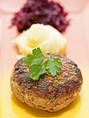 Mini meatloaf patty with red cabbage and puree