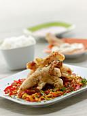 Peking Pork chops- breaded, deep-fried pork Chops on sweet and sour vegetables