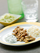 Pan-fried chicken gyros with coleslaw, rice, and tzatziki sauce