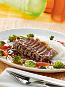 Langkawi Malaysian Rump steak with peanut sauce, vegetables, and coconut rice