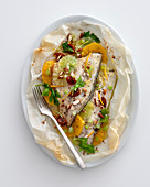 Parchment parcels filled with Sea bream fillets with citrus fruits