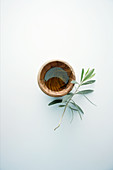Olive oil and an olive branch
