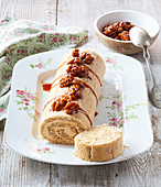 Biscuit roll with walnuts and caramel cream