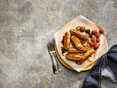 Pan-Fried pork and leek sausages with roasted cherry tomatoes and mushrooms