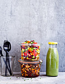 Vegan 'To Go' lunch of bean salad and chopped salad in a jar