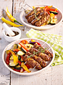 Cevapcici with baked vegetables