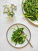 French bean salad with rocket and roasted pine nuts