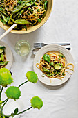 Pasta in garlic oil with green vegetables and herbs