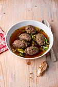 Wild liver dumpling soup