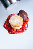 Quark soufflé with macerated strawberries and chocolate ice cream