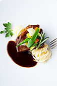 corned beef braised in Burgundy with fine vegetables and pasta