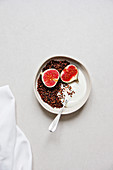Baked granola with cocoa nibs, black sesame and espresso