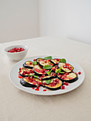 Roasted eggplant with mint and pomegranate dressing