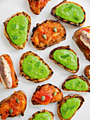 Toasted bread with pea sauce, tomato salsa and sardines