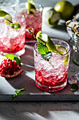 Pomegranate and raspberry gin fizz with mint and lime