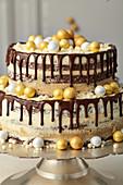 Chocolate drip cake with caramel and espresso cream