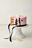 Pink wedding cake with black paper cut tattoos