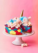 Colorful unicorn cheesecake cake