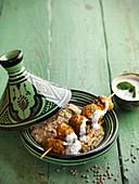 Oriental lamb skewer with hummus