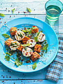 Grilled pumpkin and goat's cheese skewers with chilli and coriander