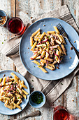Penne pasta with goat cheese and carmelized red onion sauce