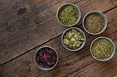 Variety of dried herbs in small bowls