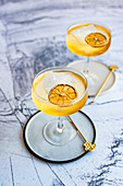 Hazelnut cocktail with dried lemon slices